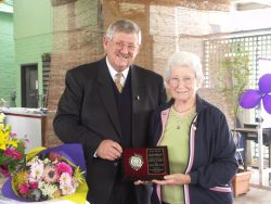 Bob Willey presenting the life membership award to Isobel Attwood