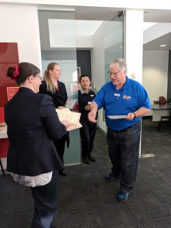 Our President, Paul Etherington, presenting the Certificate of Appreciation to Westpac Bank Warragul staff members